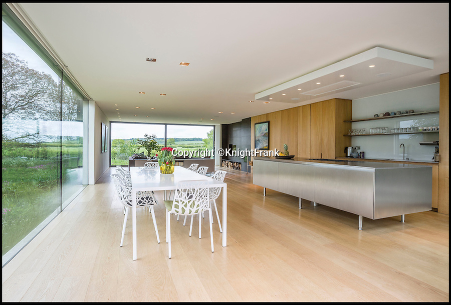 BNPS.co.uk (01202 558833)<br /> Pic: KnightFrank/BNPS<br /> <br /> The open plan kitchen and dining area with panoramic views.<br /> <br /> Escape the rat race...<br /> <br /> Homebuyers can get back to nature in style with this stunning modern barn which comes with its own natural swimming pond.<br /> <br /> From the outside Far End has been cleverly designed to blend into its natural surroundings but inside the £2.95million house is anything but basic.<br /> <br /> The house sits on the edge of Kingham, a village on the Gloucestershire/Oxfordshire borders, and has incredible views of the surrounding Cotswold countryside.