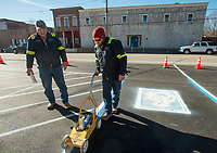 NWA Democrat-Gazette/BEN GOFF @NWABENGOFF<br /> Seth Hughes (right) with Centerton Public Works and Everett Wood, Centerton streets supervisor, paint lines Tuesday, Jan. 8, 2019, on a repaved section of parking lot in front of Centerton City Hall. The project repaired a pothole that was collecting water, according to Wood, and extended the paving a short distance into the adjacent gravel parking lot.
