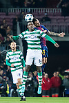 William Carvalho (l) of Sporting CP competes for the ball with Francisco Alcacer Garcia, Paco Alcacer, of FC Barcelona during the UEFA Champions League 2017-18 match between FC Barcelona and Sporting CP at Camp Nou on 05 December 2017 in Barcelona, Spain. Photo by Vicens Gimenez / Power Sport Images
