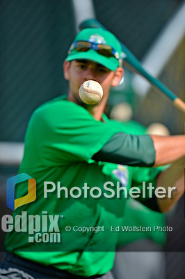 19 July 2012: A Vermont Lake Monster keeps his eye on a baseball  while tapping out infield drills prior to a game against the Tri-City ValleyCats at Centennial Field in Burlington, Vermont. The ValleyCats defeated the Lake Monsters 6-3 in NY Penn League action. Mandatory Credit: Ed Wolfstein Photo