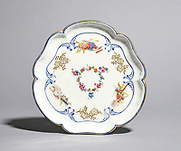 BNPS.co.uk (01202 558833)<br /> Pic: Woolley&Wallis/BNPS<br /> <br /> £8125 - Louis XV plate.<br /> <br /> One woman's lifetime collection of French porcelain that filled 'every nook and cranny' of her modest home sold for £373,000 yesterday, over £125,000 over estimate.<br /> <br /> The late Judith Howard's passion for 18th century gallic ceramics saw the walls, shelves and display cabinets adorned with hundreds of plates, dishes and bowls.<br /> <br /> She was well known for having an eye for a bargain, so much so that a 250-year-old plate she bought for £13 at an antiques shop sold for £31,000.<br /> <br /> The item was once part of the 1,735 dinner service set made for French King Louis XV and housed in the Palace of Versailles.