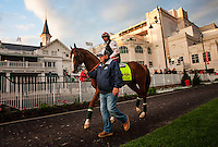 May 01, 2014: Assistant trainer, Alan Sherman leads California Chrome while schooling at Churchill Downs in Louisville Ky. Alex Evers/ESW/CSM