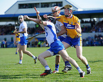 Conor Gleeson of Waterford  in action against Jamie Shanahan of Clare during their National League game at Cusack Park. Photograph by John Kelly.