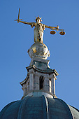 The figure of justice, by Frederick William Pomeroy, on top of the Old Bailey Central Criminal Court in London