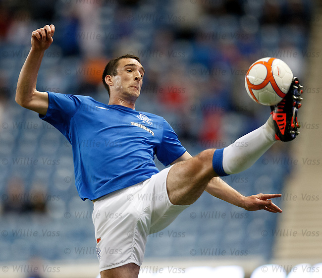 Lee Wallace traps the ball on the touchline and keeps it in play