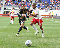 Nick Zimmerman #23 of the Philadelphia Union challenges Jeremy Hall #17 of the New York RedBulls for a loose ball during a MLS  match on April 24 2010, at RedBull Arena, in Harrison, New Jersey. RedBulls won 2-1.