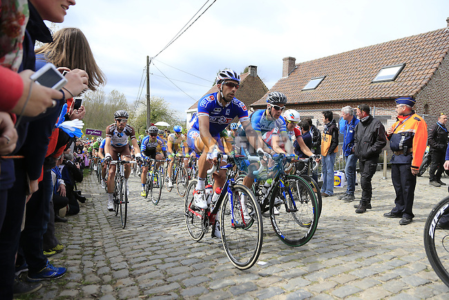The peleton, including William Bonnet (FRA) FDJ.fr, climb the Molenberg during the 2014 Tour of Flanders, Belgium.<br /> Picture: Eoin Clarke www.newsfile.ie