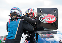 Oct 20, 2019; Ennis, TX, USA; NHRA top alcohol funny car driver Sean Bellemeur (right) is congratulated by Shane Westerfield as he celebrates after winning the Fall Nationals at the Texas Motorplex. Mandatory Credit: Mark J. Rebilas-USA TODAY Sports