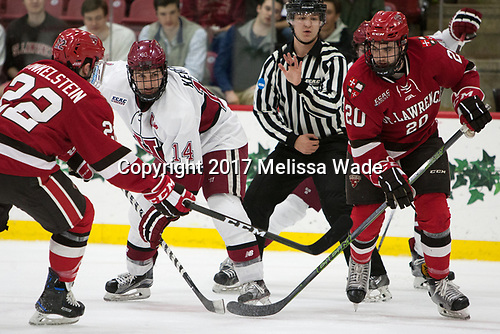 Ben Finkelstein (SLU - 22), Alexander Kerfoot (Harvard - 14), Joe Sullivan (SLU - 20) - The Harvard University Crimson defeated the St. Lawrence University Saints 6-3 (EN) to clinch the ECAC playoffs first seed and a share in the regular season championship on senior night, Saturday, February 25, 2017, at Bright-Landry Hockey Center in Boston, Massachusetts.