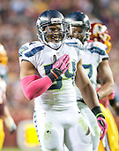 Seattle Seahawks middle linebacker Bobby Wagner (54) celebrates a sack in the third quarter of the game against the Washington Redskins at FedEx Field in Landover, Maryland on Monday, October 6, 2014.  The Seahawks won the game 27 - 17.<br /> Credit: Ron Sachs / CNP