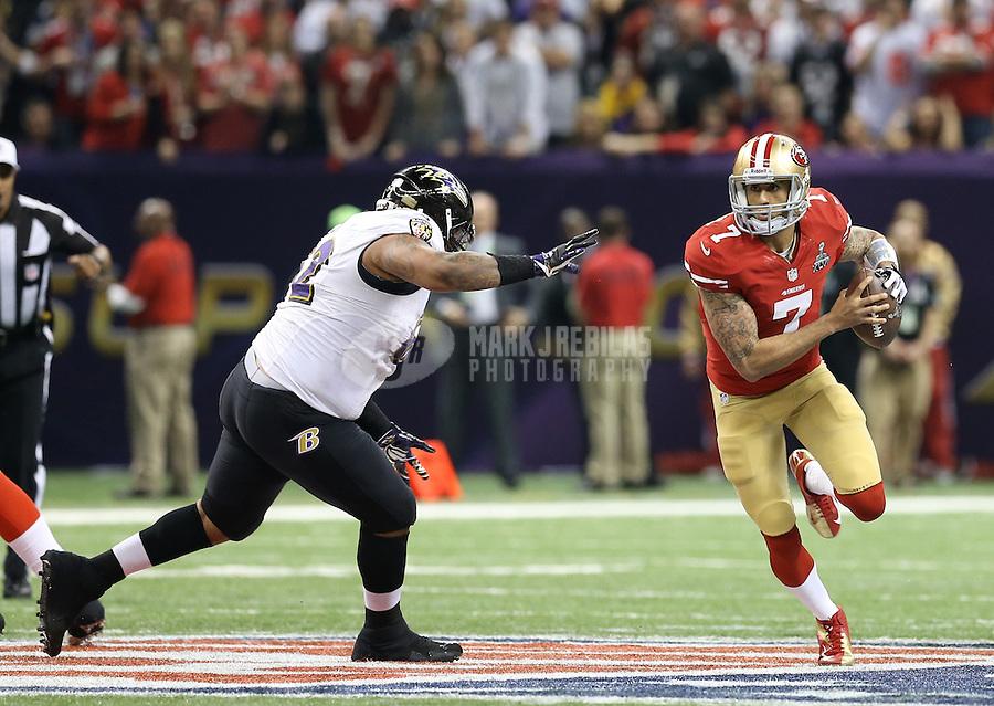 Feb 3, 2013; New Orleans, LA, USA; San Francisco 49ers quarterback Colin Kaepernick (7) scrambles past Baltimore Ravens defensive end Haloti Ngata (92) in the first quarter in Super Bowl XLVII at the Mercedes-Benz Superdome. Mandatory Credit: Mark J. Rebilas-