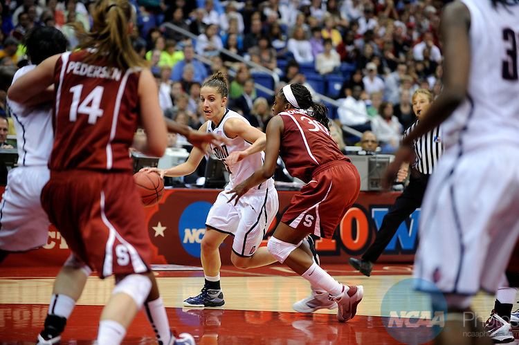 06 APR 2010: Caroline Doty (5) of the University of Connecticut drives to the basket while Nnemkadi Ogwumike (30) of Stanford moves in to block her during the Division I Women's Basketball Championship held at the Alamodome in San Antonio, TX. Connecticut defeated Stanford 53-47 for the national title. Stephen Nowland/NCAA Photos