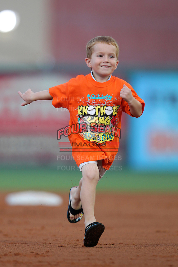 Palm Beach Cardinals in game promotion as a young fan runs the bases during a game against the Fort Myers Miracle at Roger Dean Stadium on May 1, 2012 in Jupiter, Florida.  Palm Beach defeated Fort Myers 9-3.  (Mike Janes/Four Seam Images)