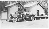Conoco truck standing beside Conoco warehouse.<br /> Dolores, CO  1930-1939