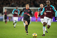 Alexis Sanchez of Arsenal under pressure from Angelo Ogbonna of West Ham United during the Premier League match between West Ham United and Arsenal at the Olympic Park, London, England on 13 December 2017. Photo by Andy Rowland.