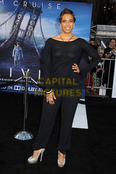 "Daphne Wayans.""Oblivion"" Los Angeles Premiere held at the Dolby Theatre, Hollywood, California, USA..April 10th, 2013.full length black top trousers see through thru nipples tape clutch bag hand on hip.CAP/ADM/BP.©Byron Purvis/AdMedia/Capital Pictures."