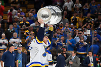 June 12, 2019: St. Louis Blues defenseman Carl Gunnarsson (4) hoists the Stanley Cup at game 7 of the NHL Stanley Cup Finals between the St Louis Blues and the Boston Bruins held at TD Garden, in Boston, Mass.  The Saint Louis Blues defeat the Boston Bruins 4-1 in game 7 to win the 2019 Stanley Cup Championship.  Eric Canha/CSM.