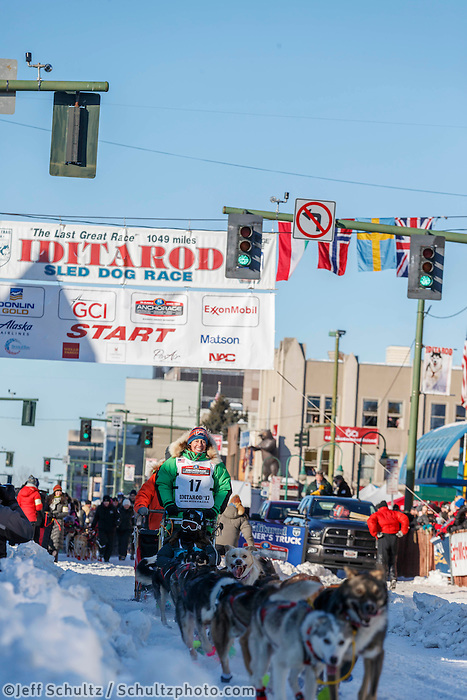 Kristin Bacon runs down 4th avenue during the Ceremonial Start of the 2017 Iditarod in Anchorage on Saturday March 4, 2017 <br /> <br /> Photo by Jeff Schultz/SchultzPhoto.com  (C) 2017  ALL RIGHTS RESVERVED