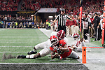 ATLANTA, GA - JANUARY 08: Terry Godwin #5 of the Georgia Bulldogs is tackled near the goal line against Ronnie Harrison #15 of the Alabama Crimson Tide during the College Football Playoff National Championship held at Mercedes-Benz Stadium on January 8, 2018 in Atlanta, Georgia. Alabama defeated Georgia 26-23 for the national title. (Photo by Jamie Schwaberow/Getty Images)