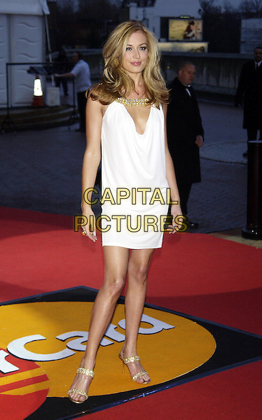 CAT DEELEY.Brit Awards 2004 at Earl's Court.17 February 2004.full length, full-length, white dress, gold sandals.www.capitalpictures.com.sales@capitalpictures.com.©Capital Pictures