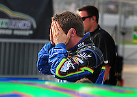 Jul. 4, 2008; Daytona Beach, FL, USA; NASCAR Sprint Cup Series driver J.J. Yeley reacts after failing to qualify for the Coke Zero 400 at Daytona International Speedway. Mandatory Credit: Mark J. Rebilas-