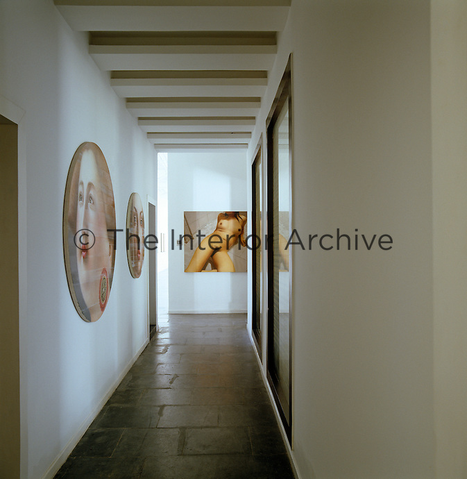 Round portraits by Ling Jians Tondo and a nude by Xu Wentao hang on the walls of the narrow corridor
