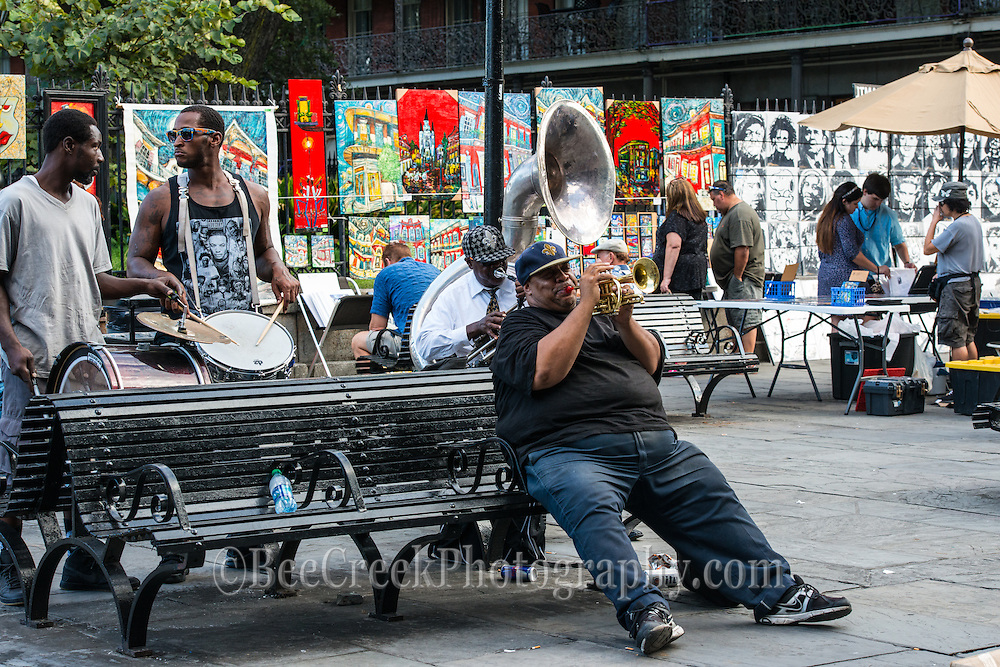 Music being played in Jackson Square along wth the art on the fences on display as tourist shopping and enjoy the sound of New Orleans.