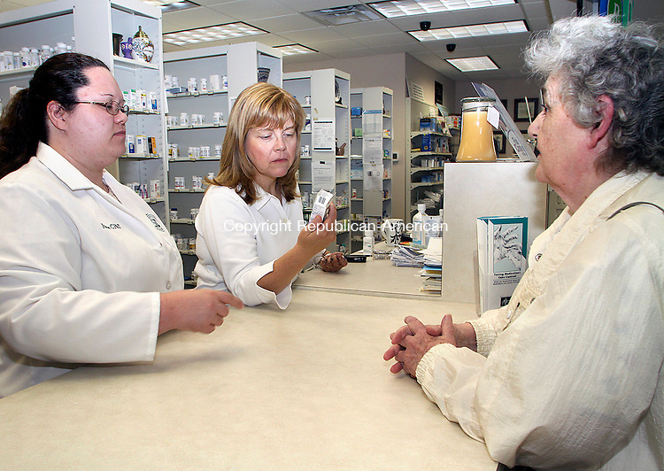 BEACON FALLS JUNE CT.-17  JUNE 2010-061710DA01- Maryellen Cameron, right, of Beacon Falls drops off her prescription to  pharmacist and co owner of  Beacon Falls Pharmacy Marion Bradley, center, and certified pharmacy technician Rose Sullivan on Thursday. <br /> Republican American  Darlene Douty