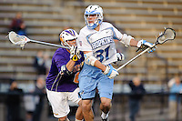 Baltimore, MD - April 5: Midfielder John Ranagan #31 of the John Hopkins Blue Jays drives toward the cage during the Albany v Johns Hopkins mens lacrosse game at  Homewood Field on April 5, 2012 in Baltimore, MD. (Ryan Lasek/Eclipse Sportwire)