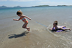 Mary Susan macMOnagle with Amelie and Sphie Hussey on Ballinskelligs Beach in JUne 2014.<br /> Picture by Don MacMonagle
