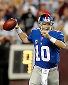 Landover, MD - September 23, 2007 -- New York Giants quarterback Eli Manning (10) looks to pass during a scoring drive in the fourth quarter against the Washington Redskins at FedEx Field in Landover, MD on Sunday, September 23, 2007.  The Giants won the game 24 - 17..Credit: Ron Sachs / CNP.(RESTRICTION: NO New York or New Jersey Newspapers or newspapers within a 75 mile radius of New York City)