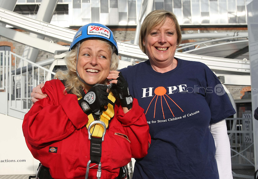 25/08/'10 Teena Gates, Head of News at 98FM pictured with Rosaleen Thomas Fundraising Director Hope Foundation at the Wheel of Dublin at the O2 this morning preparing to abseil the 60 meters down from the top of the Wheel. After climbing her own personal mountain, recovering from illness, chronic back pain and loosing 10 stone in 12 months, Teena is heading to Mount Everest Base Camp this October as part of a celebrity fundraiser for the Hope Foundation and street kids in Calcutta....Picture Colin Keegan, Collins, Dublin.