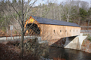 Downers or Upper Falls Covered Bridge in Weathersfield,  Vermont USA. This bridge crosses over Black River.