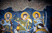 Belgrade, Serbia, Yugoslavia. Mural depicting Medieval saints or knights with swords and spears; Belgrade Fort.