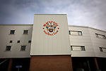 An exterior view of Bloomfield Road stadium before Blackpool hosted Portsmouth in an English League One fixture. The match was proceeded by a protest by around 500 home fans against the club's controversial owners Owen Oyston, many of whom did not attend the game. The match was won by the visitors by 2-1 with two goals by Ronan Curtis watched by just 4,154 almost half of which were Portsmouth supporters.