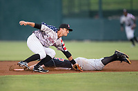 Grant Massey (28) of the Kannapolis Intimidators reaches for a throw as Blaine Prescott (25) of the Hickory Crawdads steals second base in game two of a double-header at Kannapolis Intimidators Stadium on May 19, 2017 in Kannapolis, North Carolina.  The Intimidators defeated the Crawdads 9-1.  (Brian Westerholt/Four Seam Images)