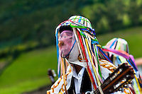 "A man, wearing colorful costume, play guitar during the Inti Raymi festival in Pichincha province, Ecuador, 27 June 2010. Inti Raymi, ""Festival of the Sun"" in Quechua language, is an ancient spiritual ceremony held in the Indian regions of the Andes, mainly in Ecuador and Peru. The lively celebration, set by the winter solstice, goes on for various days. The highland Indians, wearing beautiful costumes, dance, drink and sing with no rest. Colorful processions in honor of the God Inti (Sun) pass through the mountain villages giving thanks for the harvest and expressing their deep relation to the Mother Earth (Pachamama)."