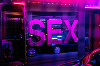 "Switzerland. Geneva. The Paquis neighborhood is known for its nightlife and Red-light district. Street prostitution. Most of the prostitutes work in the streets. Others wait inside and look through the windows for customers. Prostitution is often referred to as ""the world's oldest profession"". Sex. 11.05.12 © 2012 Didier Ruef"