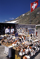 Switzerland, Ticino, Alps, St. Gotthard Pass Road, Souvenirs of Switzerland on display, for sale, on the summit of Saint Gotthard Mountain Pass in the scenic Swiss Alps in the summer.