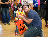 Faculty member Jesse Mora and his son. Photo from the Boo Bash in the Tiger Cooler, Oct. 30, 2015.<br />