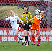 Tara Schwitter (24) of Miami controls the ball in front of Ashley Spivey (8) of Maryland during the game at Ludwig Field in College Park, MD.  Maryland defeated Miami, 2-1, in overtime.