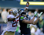 Seattle Seahawks wide receiver Jermaine Kearse (15) goes up to catch a 47-yard pass against  San Francisco 49ers  cornerback Perrish Cox (20) during the first quarter  at CenturyLink Field in Seattle, Washington on December 14, 2014.  The Seahawks beat the 49ers 17-7.   © 2014. Jim Bryant Photo. All Rights Reserved.