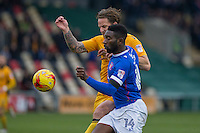 Darren Jones of Newport County battles with Jabo Ibehre of Carlisle during the Sky Bet League 2 match between Newport County and Carlisle United at Rodney Parade, Newport, Wales on 12 November 2016. Photo by Mark  Hawkins.