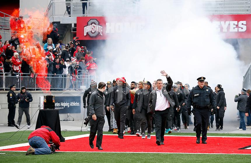 Ohio State Buckeyes head coach Urban Meyer leads his team onto the field during the celebration for winning the national championship at Ohio Stadium on Jan. 24, 2015. (Adam Cairns / The Columbus Dispatch)