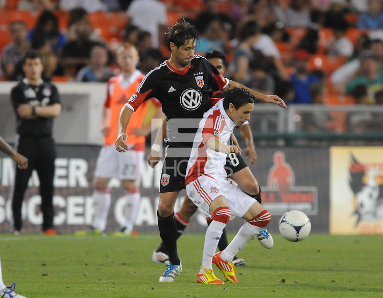 Toronto FC midfielder Eric Avila (8) shields the ball against D.C. United midfielder Branko Boskovic (8) D.C. United defeated Toronto FC 3-1 at RFK Stadium, Saturday May 19, 2012.