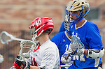 Orange, CA 03-05-17 - Hunter So (Chapman #40) and Jordan Robertson (UCLA #27) in action during the UCLA - Champman Southern Lacrosse Conference MCLA Division 1 Men's Lacrosse game.