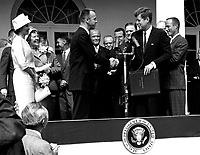 Washington D.C.USA - 05/06/1961 File photo -President John F. Kennedy congratulates astronaut Alan B. Shepard, Jr., the first American in space, on his historic May 5th, 1961 ride in the Freedom 7 spacecraft and presents him with the NASA Distinguished Service Award. The ceremony took place on the White House lawn. Shepard's wife, Louise (left in white dress and hat), and his mother were in attendance as well as the other six Mercury astronauts and NASA officals, some visible in the background.