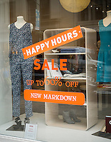 Up to 60 percent off sale at a women's clothing store in New York on Thursday, July 2, 2015.  (© Richard B. Levine)