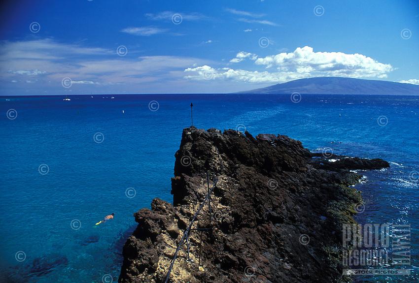 Snorkeling near the rocks off Kaanapali beach, near the Sheraton hotel, Island of Maui