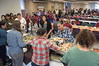 Staff, faculty and students enjoy the Interfaith Thanksgiving Luncheon in Lower Herrick on Nov. 17, 2015. Turkey and all the trimmings, vegan options and pie, plus student representatives from six different on-campus faith groups spoke about faith, community, thankfulness, peace and tradition, among other things.<br />
